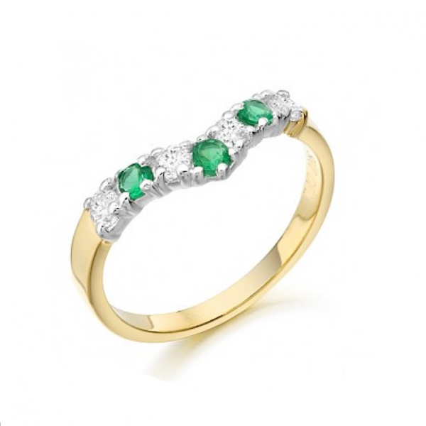 Nine carat gold Wishbone ring set with cubic stones and synthetic green emeralds